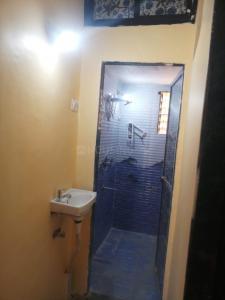 घनसोली में न्यू बॉम्बे पीजी के बाथरूम की तस्वीर