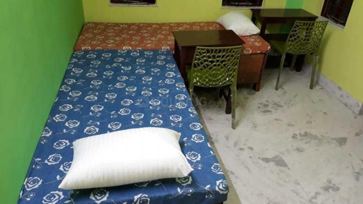 संतरागाची में ज्योति रेसिडेंसी के बेडरूम की तस्वीर