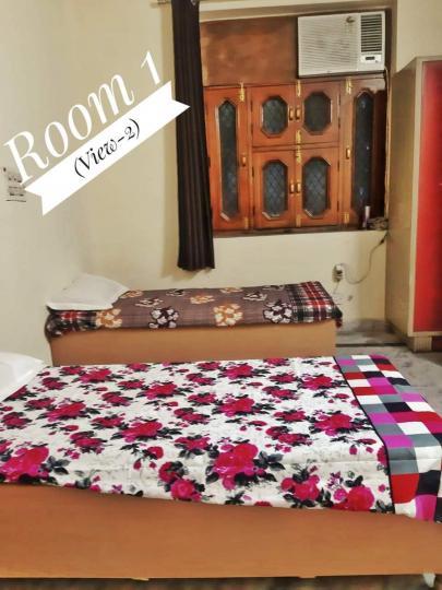 विजय नगर में हेरिटेज होम पीजी के बेडरूम की तस्वीर