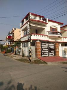 Gallery Cover Image of 1200 Sq.ft 4 BHK Villa for buy in Aman Vihar for 10000000