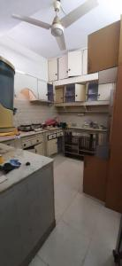Kitchen Image of Aarti PG Homes in Sarita Vihar