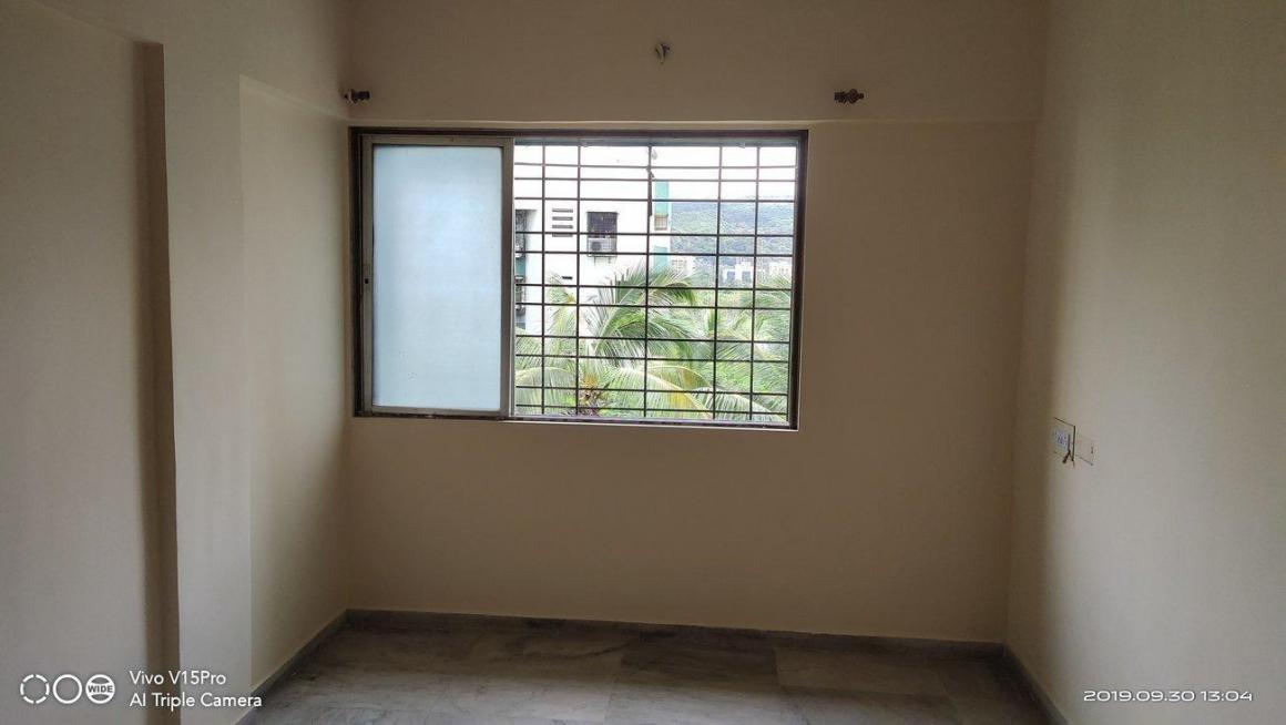 Bedroom Image of 560 Sq.ft 1 BHK Apartment for rent in Dahisar East for 17000