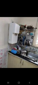 Kitchen Image of One Full Room In Preoccupied 2bhk Fully Furnished Flat in Vaibhav Khand
