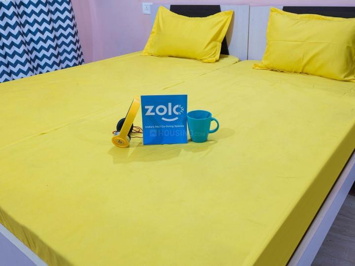 पेरुंगुड़ी में ज़ोलो गृह के बेडरूम की तस्वीर