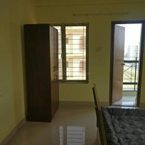 न्यू टाउन में चक्रबर्ती पीजी के बेडरूम की तस्वीर