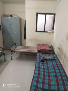 Bedroom Image of Shree Swami Hostel in Parvati Darshan