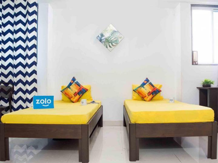 कर्वे नगर में ज़ोलो सेरेनिटी के बेडरूम की तस्वीर