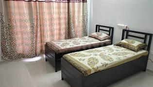 सेक्टर 50 में बॉइज़ पी.जी के बेडरूम की तस्वीर