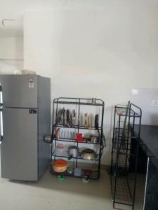 Kitchen Image of Shree Ganesh PG in Hinjewadi