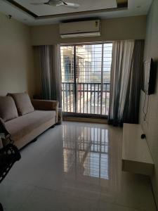 Gallery Cover Image of 890 Sq.ft 2 BHK Apartment for rent in Chandak Paloma, Goregaon East for 45000