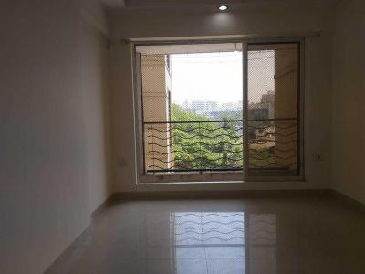 Gallery Cover Image of 675 Sq.ft 1 BHK Apartment for rent in Malad West for 24000