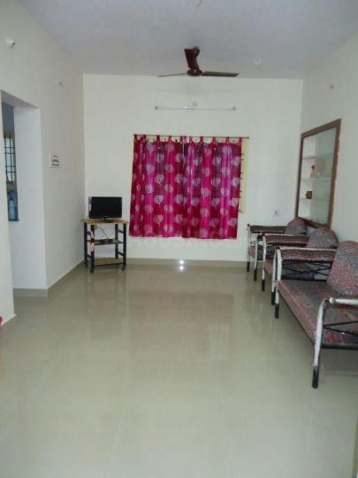 रामपुरम में दुर्गा पीजी अकॉमोडेशन में लिविंग रूम की तस्वीर