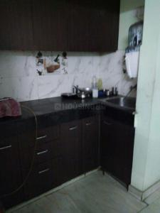 Kitchen Image of Karan PG in Chhattarpur