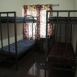 Bedroom Image of Shree Kumuda PG For Men's Hi-tech in Banashankari
