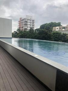 Gallery Cover Image of 1250 Sq.ft 2 BHK Apartment for buy in Prestige Pinewood, Koramangala for 18000000