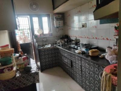 Kitchen Image of 1100 Sq.ft 2 BHK Apartment for buy in Madan Mahal for 4500000