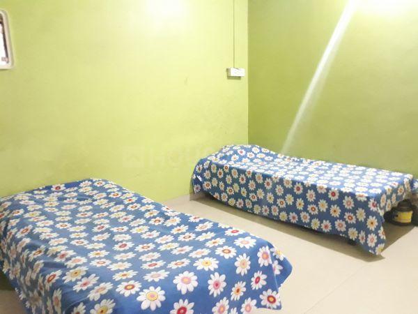 कर्वे नगर में युवा हाउसिंग पीजी में बेडरूम की तस्वीर