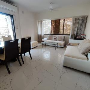 Gallery Cover Image of 980 Sq.ft 2 BHK Apartment for rent in Raj Paradise, Andheri East for 46000