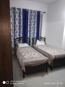 Bedroom Image of N.singh Rajput PG in Wakad