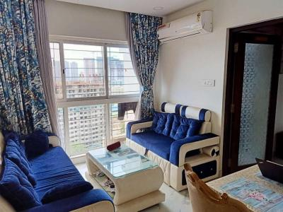 Gallery Cover Image of 710 Sq.ft 2 BHK Apartment for rent in Raheja Ridgewood, Goregaon East for 45000