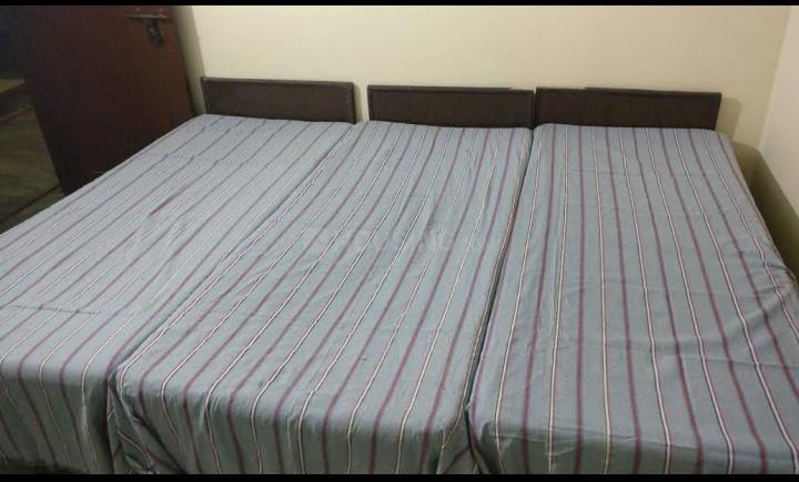 Bedroom Image of Paryag PG in Sector 17