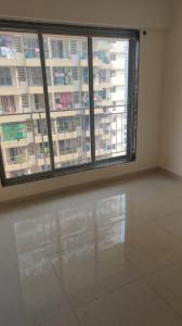 Gallery Cover Image of 680 Sq.ft 1 BHK Apartment for rent in Dharti Pressidio, Kandivali West for 23000