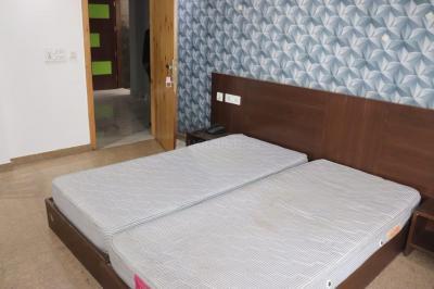सेक्टर 31 में शोभा गर्ल्स पीजी के बेडरूम की तस्वीर