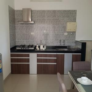 Gallery Cover Image of 1198 Sq.ft 2 BHK Apartment for buy in Gagan Micasaa, Wagholi for 4500000