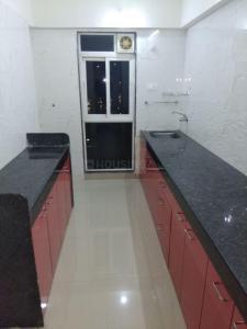 भांडूप वेस्ट में ऑक्सोटेल पेइंग गेस्ट के किचन की तस्वीर