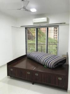 Gallery Cover Image of 1090 Sq.ft 2 BHK Apartment for rent in Ajmera Divyam Heights, Andheri West for 40000