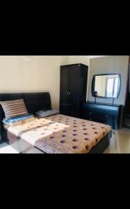 वस्त्रपुर में विजय कॉर्पोरेट पीजी के बेडरूम की तस्वीर