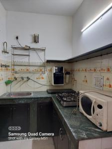 Kitchen Image of PG 6958845 Khanpur in Khanpur