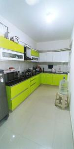 Gallery Cover Image of 1285 Sq.ft 2 BHK Apartment for rent in Saroj Harmony, Halasahalli for 18000