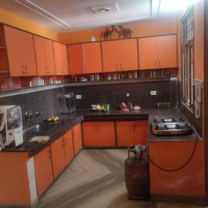 Kitchen Image of PG in Madhu Vihar