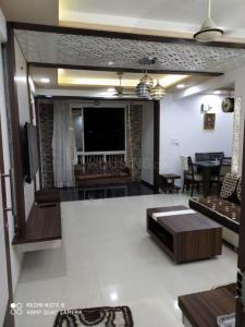 Gallery Cover Image of 1557 Sq.ft 3 BHK Apartment for buy in Poddar Palm Greens, Makarba for 9000000