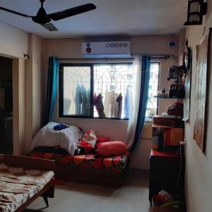 Gallery Cover Image of 950 Sq.ft 1 BHK Apartment for rent in Kopar Khairane for 22000