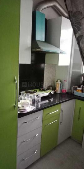 Kitchen Image of PG For Girls Fully Furnished Rooms in Uttam Nagar