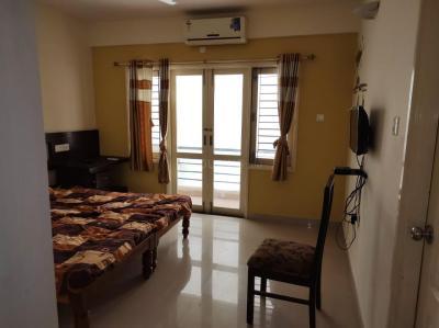 डोमलूर लेआउट में करुणा अपार्टमेंट्स के बेडरूम की तस्वीर