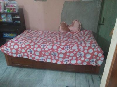 Bedroom Image of Majumdars PG in Purba Barisha
