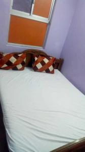 Bedroom Image of Sanjay Guest House in Periyamet