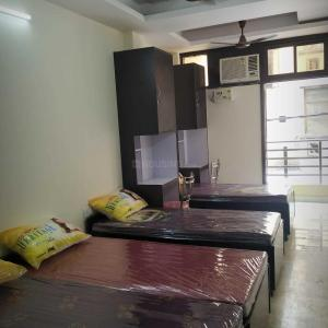 Bedroom Image of New Greenhigh Homes PG in Laxmi Nagar