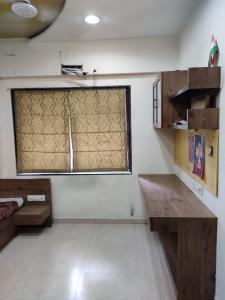 Bedroom Image of Gurukrupa Ph in Navrangpura