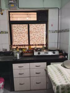 Kitchen Image of 610 Sq.ft 1 BHK Apartment for buy in Akhurath CHS, Sanpada for 8500000