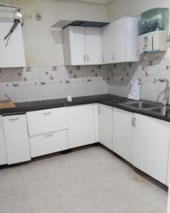 Kitchen Image of Nri PG in Knowledge Park 3