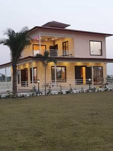 Gallery Cover Image of 990 Sq.ft 2 BHK Independent House for buy in Dkrrish Green Beauty Farms, Nagli Sabapur for 5225000