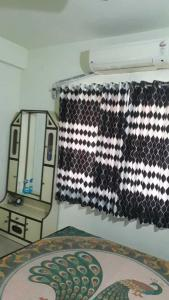 Gallery Cover Image of 900 Sq.ft 1 BHK Apartment for rent in Jodhpur for 19000