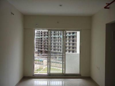 Gallery Cover Image of 691 Sq.ft 1 BHK Apartment for rent in JP North, Mira Road East for 16000
