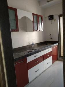 Gallery Cover Image of 610 Sq.ft 1 BHK Apartment for rent in Malad West for 25000