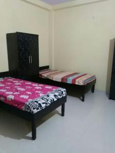 Bedroom Image of Abhinav Associates PG in Sector 2 Dwarka