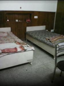Bedroom Image of Varsha PG in Greater Kailash